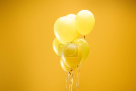 Photo for Colorful minimalistic decorative balloons on yellow background - Royalty Free Image