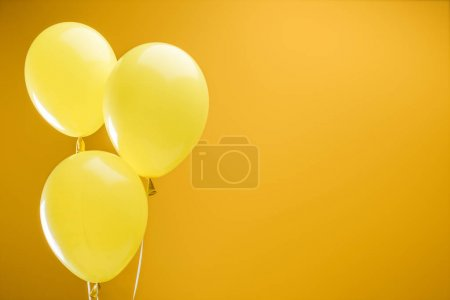 Photo for Festive bright minimalistic decorative balloons on yellow background with copy space - Royalty Free Image