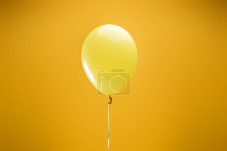 Photo for Festive bright minimalistic decorative balloon on yellow background - Royalty Free Image