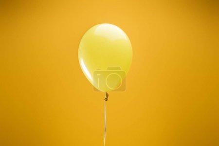 Foto de Festive bright minimalistic decorative balloon on yellow background - Imagen libre de derechos