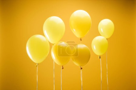 Photo for Festive minimalistic decorative balloons on yellow background - Royalty Free Image