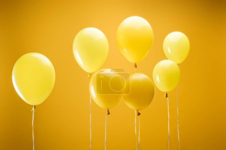 Photo pour Festive bright minimalistic decorative balloons on yellow background - image libre de droit