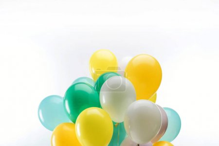 Photo for Bright green, yellow and blue decorative balloons on white background - Royalty Free Image