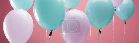 Foto de Bright party multicolored balloons on pink background, panoramic shot - Imagen libre de derechos