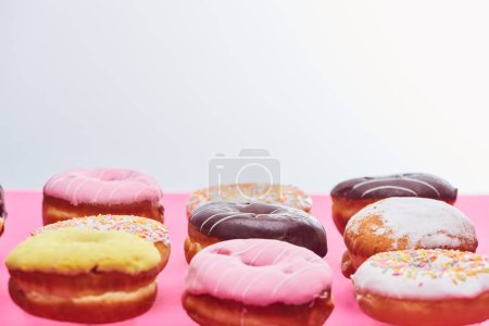 Photo for Tasty sweet glazed doughnuts on white background with copy space - Royalty Free Image
