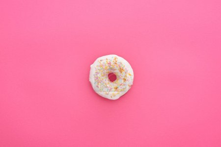 Photo for Top view of tasty glazed white doughnut with sprinkles on bright pink background - Royalty Free Image
