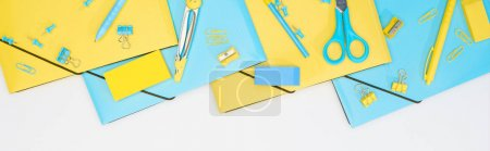 Photo for Panoramic shot of blue and yellow stationery isolated on white - Royalty Free Image