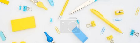 Photo for Panoramic shot of mixed yellow and blue stationery isolated on white - Royalty Free Image