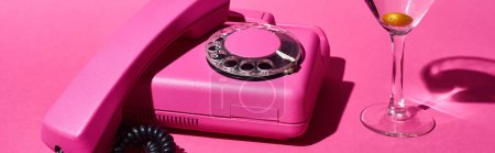 Photo for Panoramic shot of glass with cocktail and olive near vintage dial phone on pink background - Royalty Free Image
