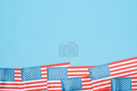 Photo for Top view of american flags on blue background with copy space - Royalty Free Image