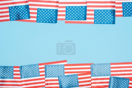 Photo for Frame of american flags on blue background with copy space - Royalty Free Image