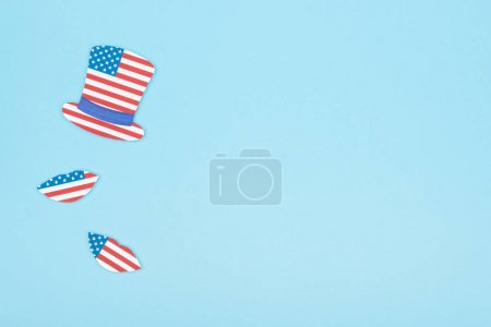 Photo for Top view of paper cut mustache and lips made of usa flags on blue background with copy space - Royalty Free Image