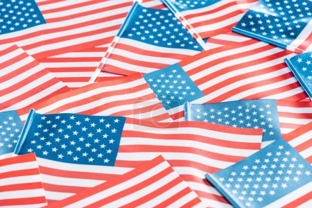 Photo pour Close up view of national american flags in pile - image libre de droit