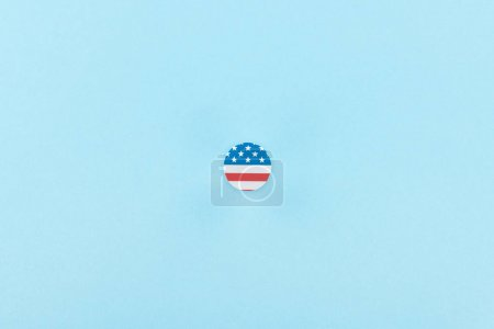 Photo for Top view of paper cut decorative circle made of american flag on blue background - Royalty Free Image