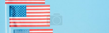 Photo for Panoramic shot of national american flags on blue background - Royalty Free Image