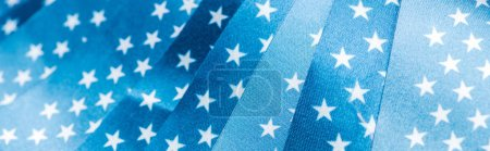 close up view of stars on glossy american flags, panoramic shot