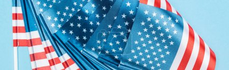 Photo for Close up view of national american flags on blue background, panoramic shot - Royalty Free Image