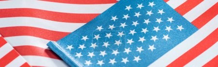 Photo for Close up view of national colorful american flags in pile, panoramic shot - Royalty Free Image