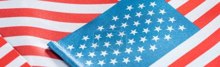 close up view of national colorful american flags in pile, panoramic shot