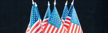 Foto de Panoramic shot of national american flags isolated on black, Independence Day concept - Imagen libre de derechos