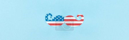Photo for Top view of decorative mustache made of american flag on blue background, panoramic shot - Royalty Free Image