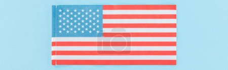 Photo pour Panoramic shot of national american flag on blue background - image libre de droit