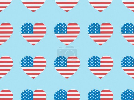Foto de Seamless background pattern with paper cut hearts made of usa flags on blue - Imagen libre de derechos