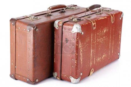 Foto de Dos maletas retro marrón cuero aislado en blanco - Imagen libre de derechos