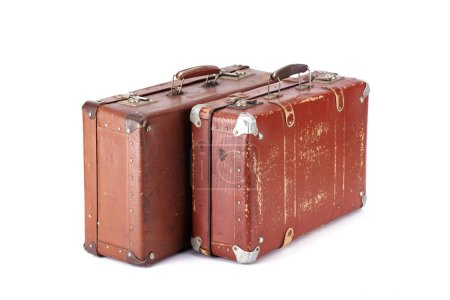 two leather brown aged vintage suitcases isolated on white