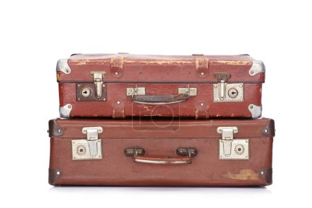 two vintage brown leather suitcases isolated on white