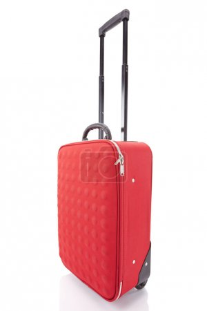 red wheeled textured colorful suitcase with handle isolated on white
