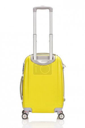 Photo for Back view of yellow plastic wheeled colorful suitcase with handle isolated on white - Royalty Free Image
