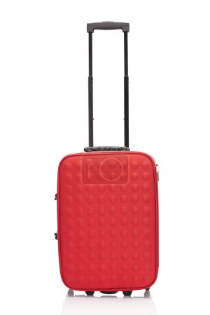 Photo for Red colorful suitcase with handle on wheels isolated on white - Royalty Free Image