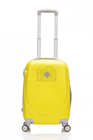Photo for Front view of yellow plastic wheeled colorful suitcase with handle isolated on white - Royalty Free Image