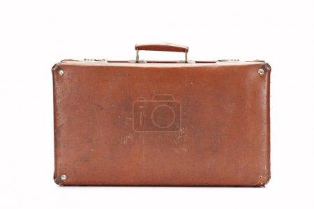 Photo pour Valise rétro brune en cuir d'isolement sur le blanc - image libre de droit