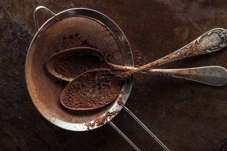 Photo for Top view of dirty strainer and vintage spoons on rust metal background - Royalty Free Image