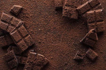 Photo for Top view of pieces of chocolate with chocolate chips on metal background - Royalty Free Image
