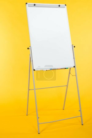 white flipchart with copy space isolated on yellow