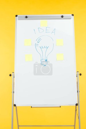 Photo for Light bulb drawn on white flipchart with sticky notes - Royalty Free Image