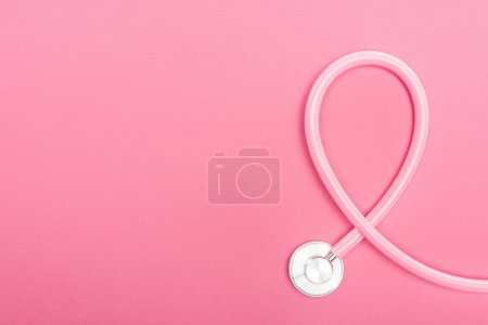 Photo for Top view of pink stethoscope on pink background with copy space - Royalty Free Image