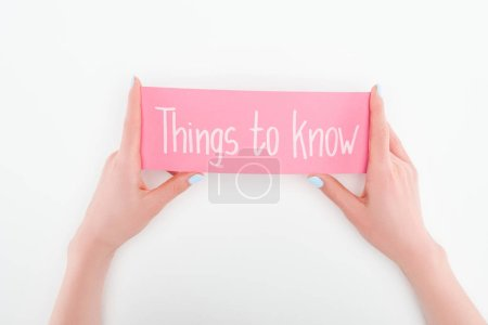 Photo for Cropped view of woman holding pink card with things to know lettering on white background - Royalty Free Image