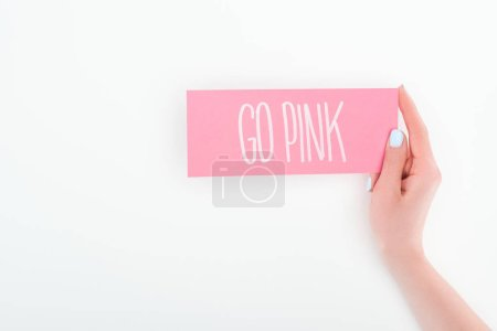 Photo for Partial view of woman holding pink card with go pink lettering on white background with copy space - Royalty Free Image