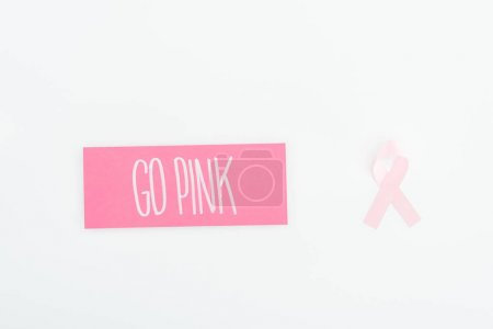 Photo for Top view of pink breast cancer sign and card with go pink lettering on white background - Royalty Free Image