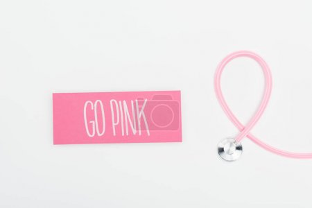 Photo for Top view of stethoscope and card with go pink lettering on white background - Royalty Free Image