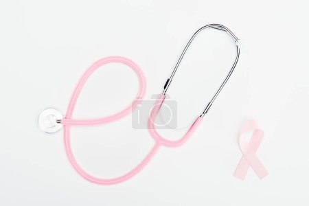 Photo for Top view of stethoscope and pink breast cancer bow on white background - Royalty Free Image