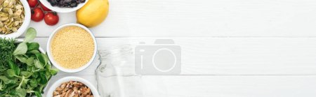 Photo for Top view of tasty food near glass jar on wooden white table with copy space, panoramic shot - Royalty Free Image