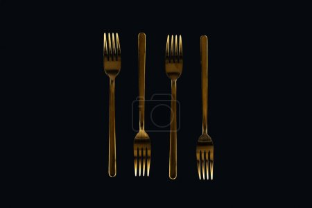 Photo for Flat lay of metal forks isolated on black - Royalty Free Image
