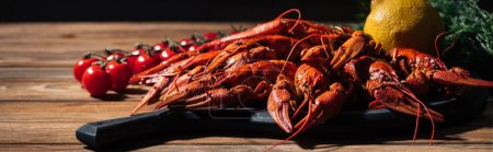 Photo for Panoramic shot of red lobsters, dill, lemon and tomatoes on wooden surface - Royalty Free Image