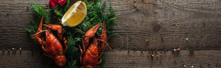 Photo for Panoramic shot of red lobsters, lemon slices and dill on wooden surface - Royalty Free Image