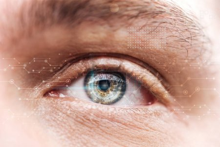 close up view of mature man eye with data illustration, robotic concept